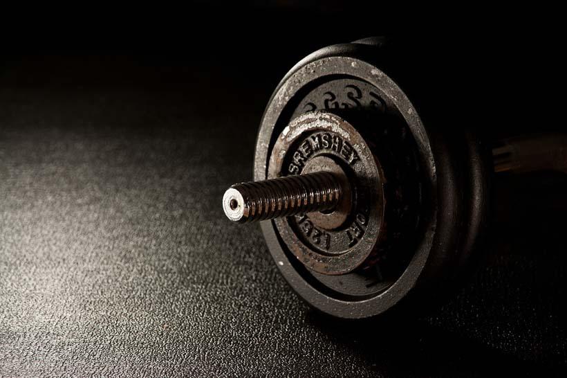 fitness-barbell for strength training on floor