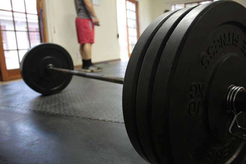 strength training barbell on floor